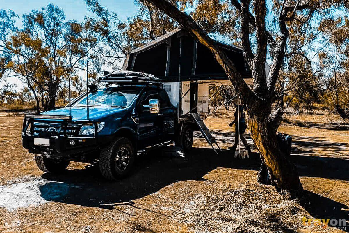 Extra Cab Ford Ranger Blue with Antenna and LED flood light under tree camping Trayon Slide on camper