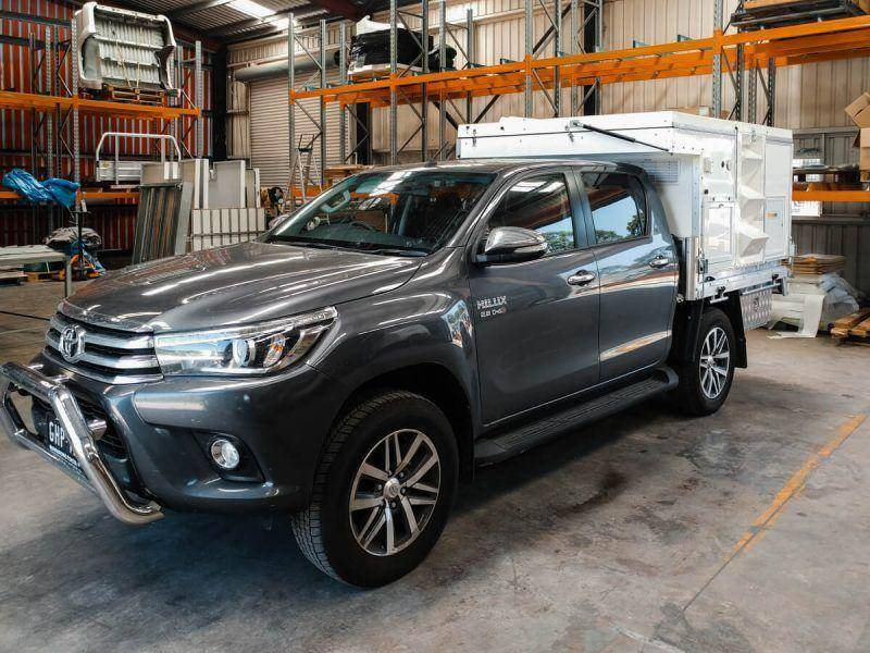 New 2018 Toyota Hilux Dual Cab Gray with Trayon Slide on camper in factory / warehouse