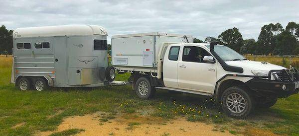 towing horse float with a slide on camper