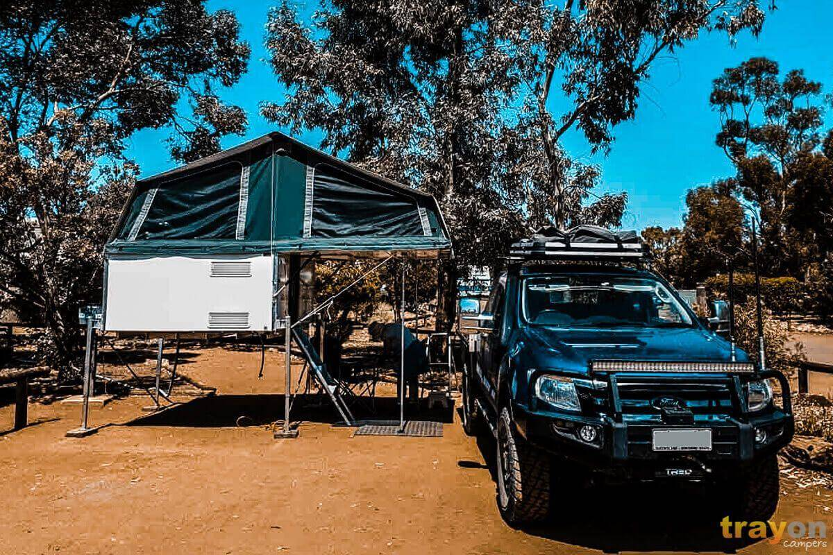 Extra Cab Ford Ranger with Trayon Slide on camper free standing blue camping out west.