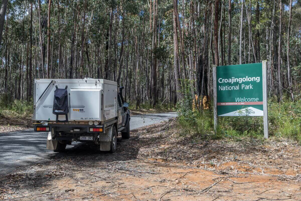 Croajingolong National Park Camping Guide - Vehicle next to welcome sign - Trayon Camper