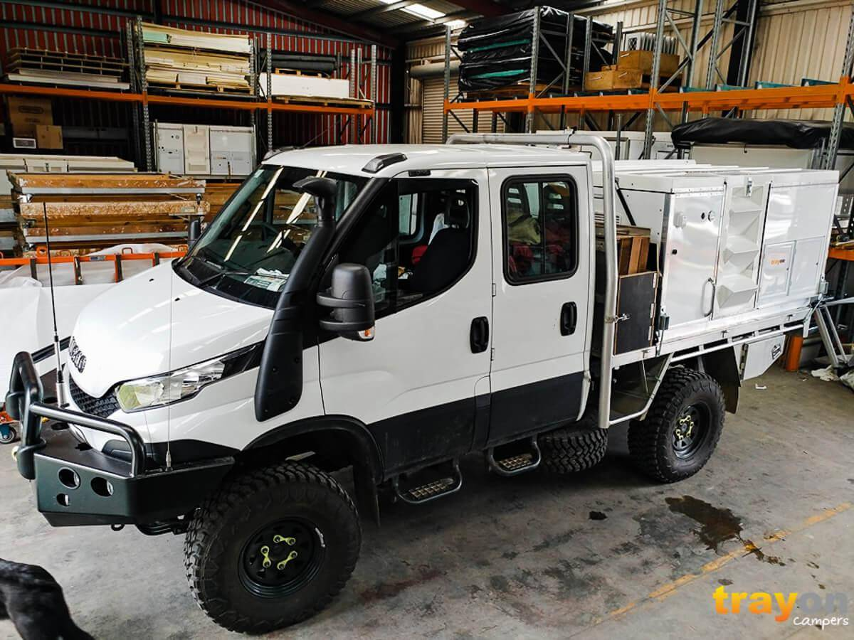Dual Cab Iveco Daily 4x4 Review with Trayon Slide on Camper in Factory. Kitted out for offroad use: Snorkle, front bar, side steps, aluminium tray. Trayon 2100 Camper