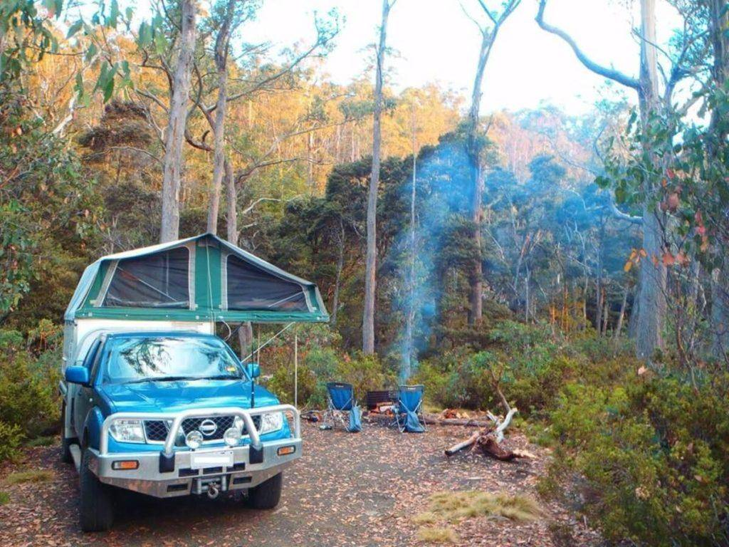 Nissan Navara Trayon Slide on Camper by campfire