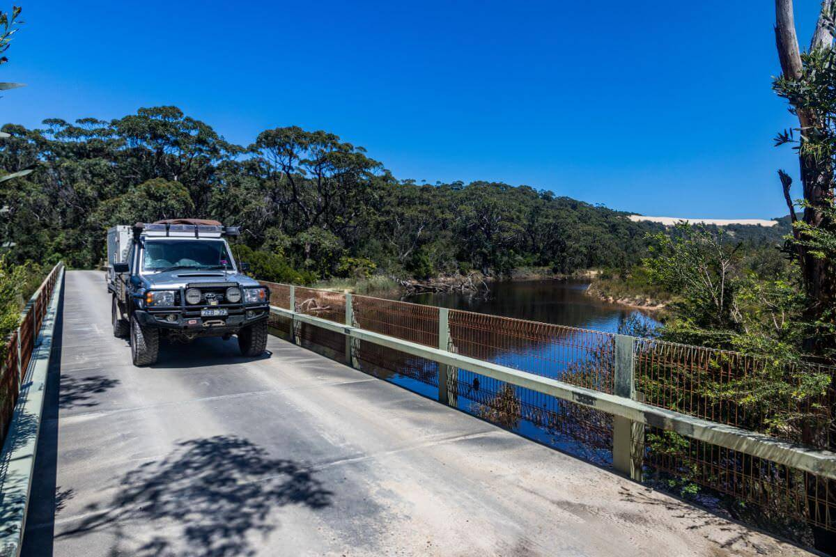 Croajingolong National Park VIC - Thurra River near point hicks. 79 Series Toyota Landcruiser Crossing Bridge - Trayon Slide on Campers