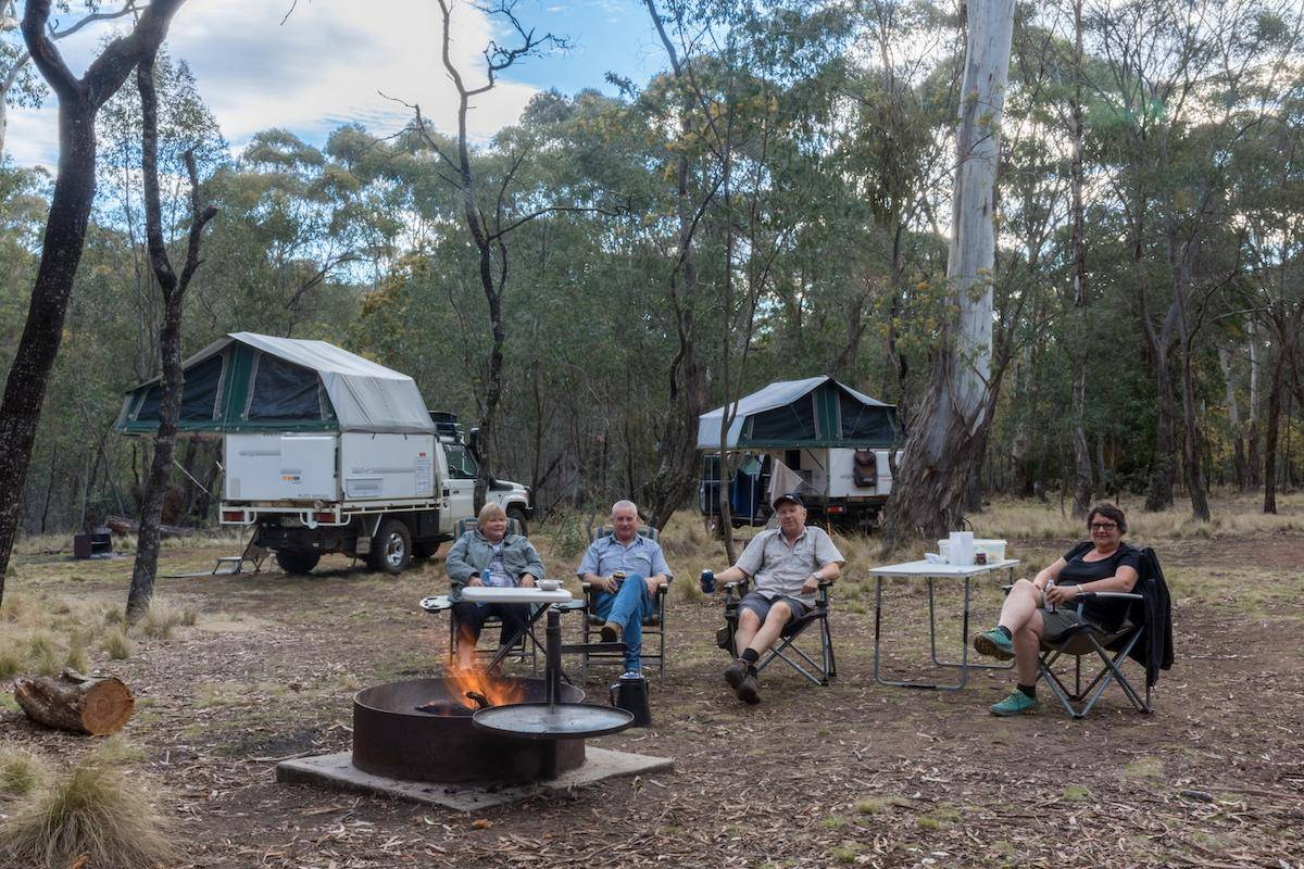 Coolah Tops National Park Camping Guide - Cox Creek Campground, Campers around a fire place Trayon Slide on Campers