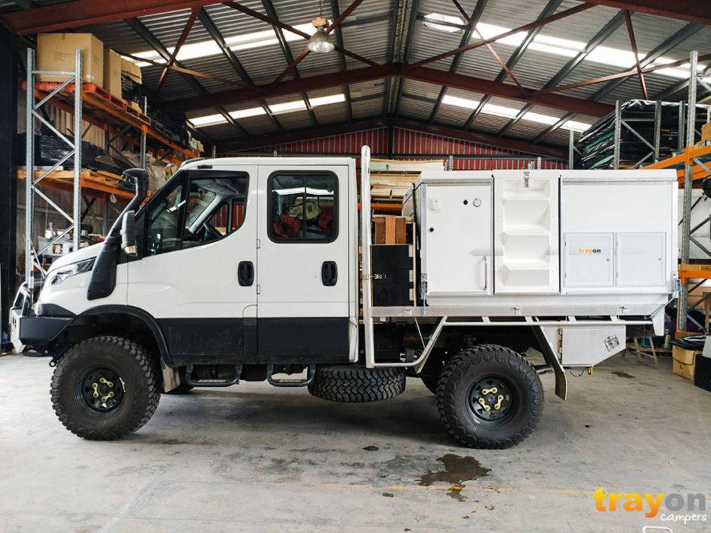 Dual Cab Iveco Daily 4x4 Review with Trayon Slide on Camper in Factory. Kitted out for offroad use: Snorkle, front bar, side steps, aluminium tray. Trayon 2100 Camper. Spare tire.