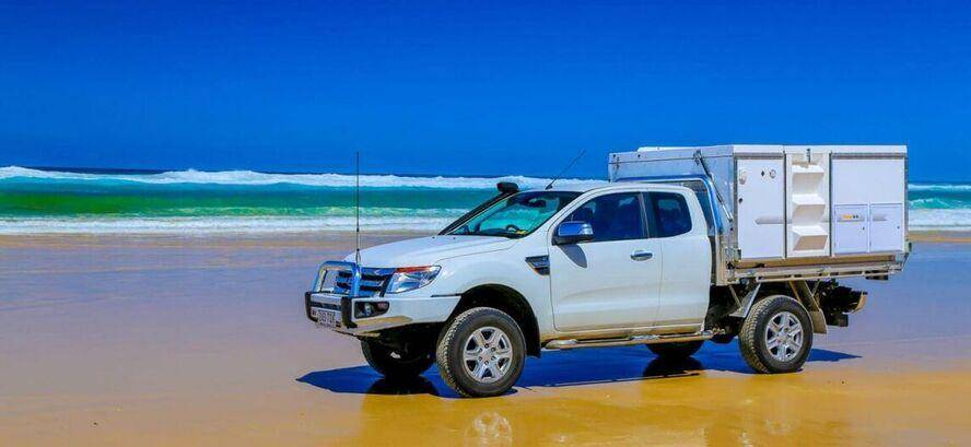 Class 2 Trayon Slide on camper on the back of a Super Cab Ford Ranger at the beach, off road, surf.