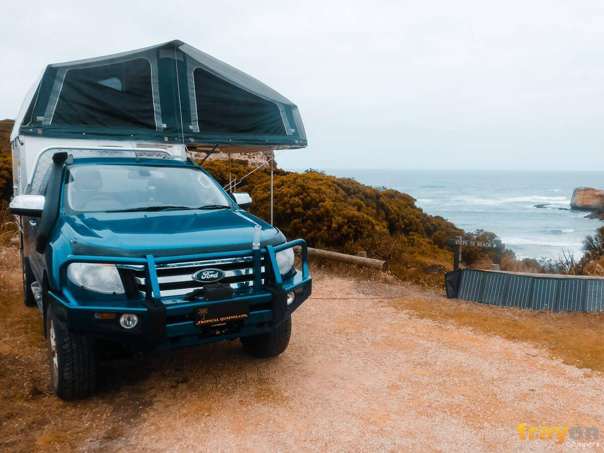 4x4 Extra Cab Ford Ranger with Trayon Slide on camper camping on the beach