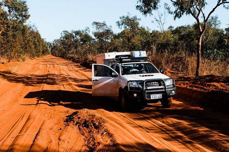 Toyota Hilux dual cab on sandy desert road in Australia with Trayon Slide on camper