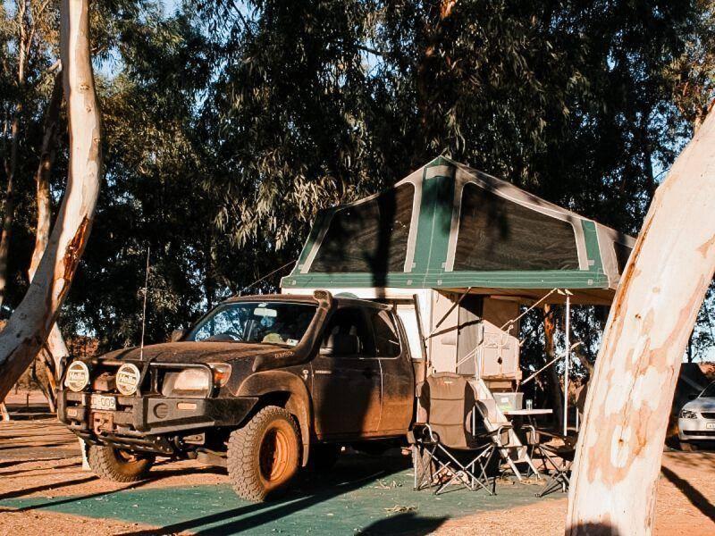 Grey 4x4 Mazda Bt-50 Freestyle Cab Trayon Slide on Camper camping under tree