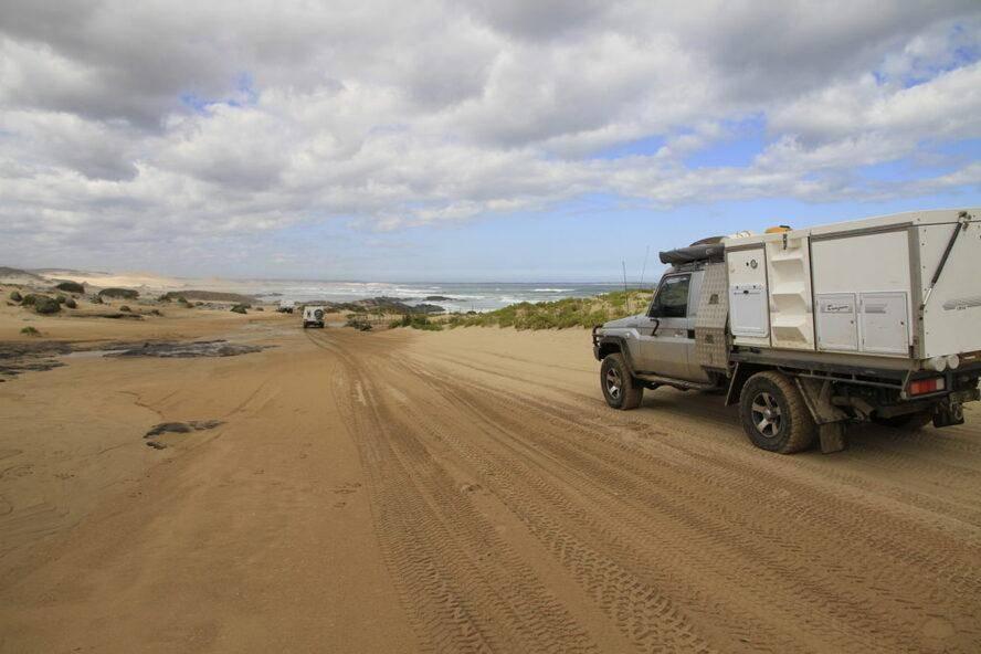 West Coast of Tasmania Sandy Cape Track 4WD Trayon Camper Landcruiser 79 Series Driving on Beach Trayon Slide on Camper ute back camper