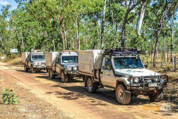 trayon camper slide on camper 4wd suspension convoy - Three Toyota Land Cruisers on dirt road