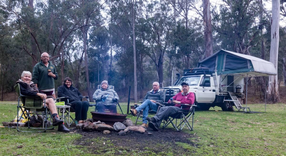 Gordon Country Campsite - Friends around campfire Trayon Camper Landcruiser