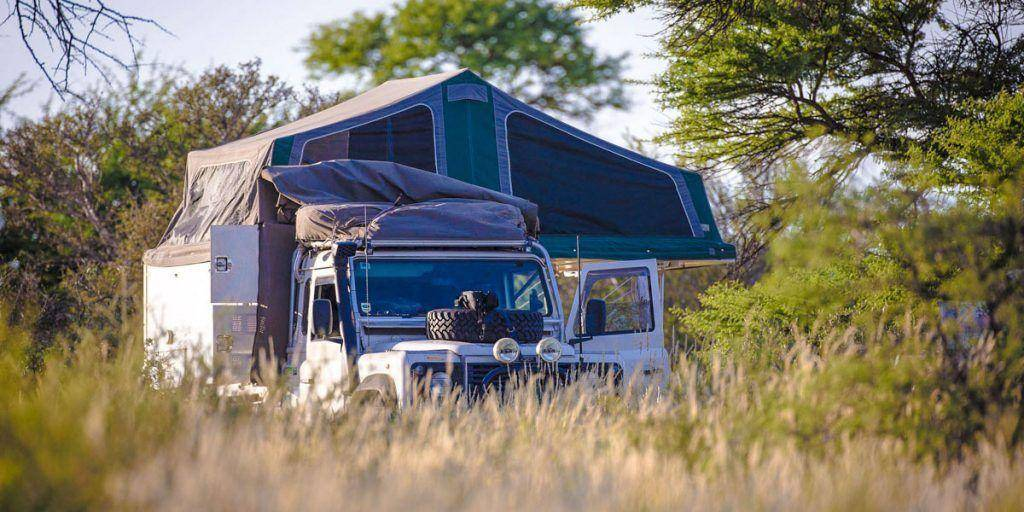 Slide on camper in Africa Safari - Single Cab Landrover Defender 110. Trayon Camper