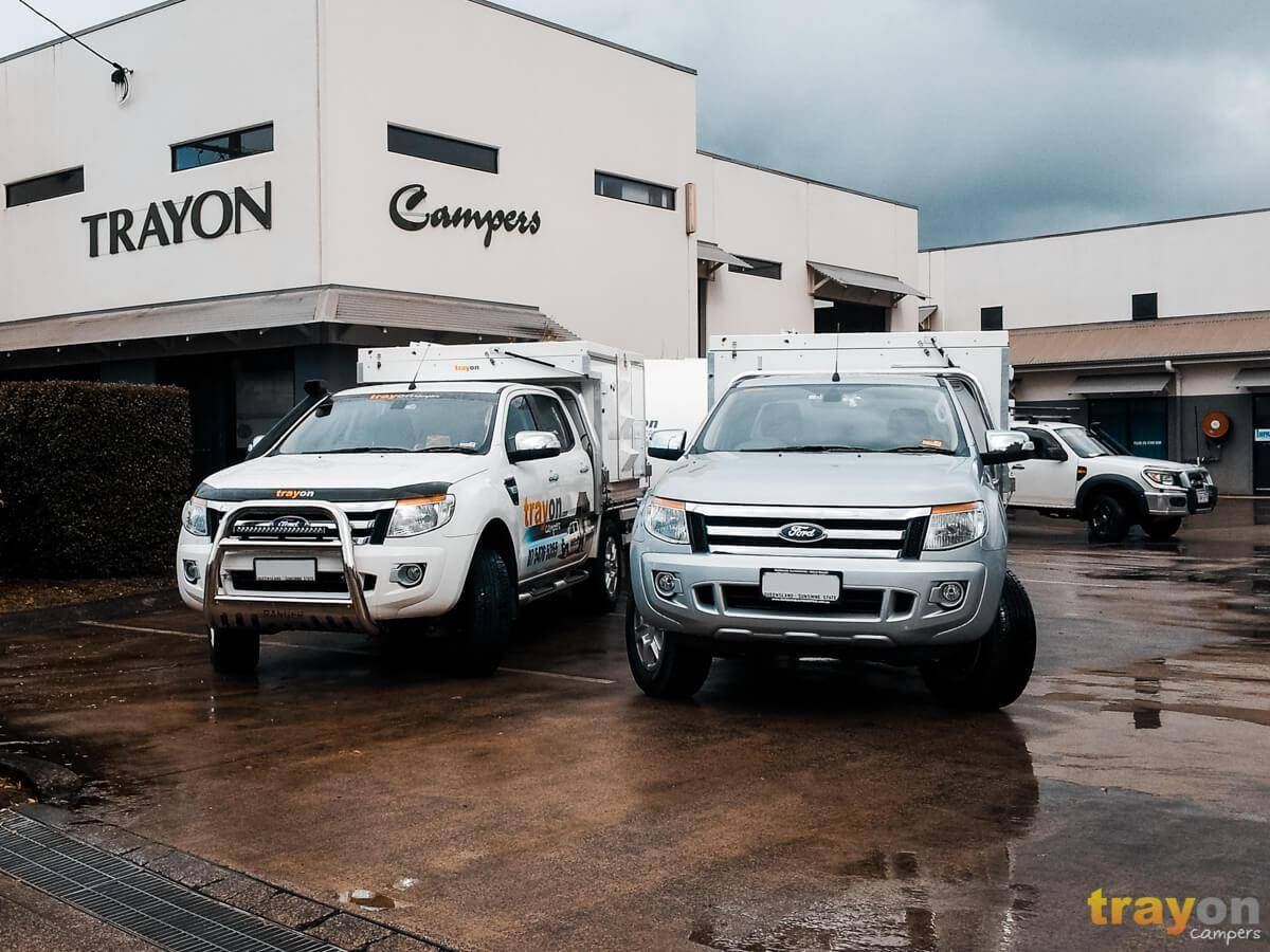 two Ford rangers in wet car park dual cab with Trayon Camper